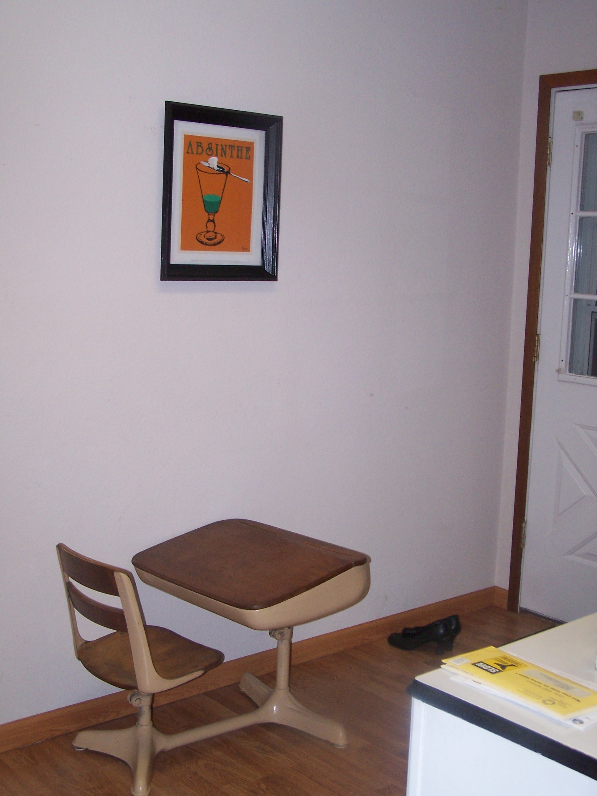 Here is the desk and the huge wall. The one picture is hung, but the other two are waiting to be framed.
