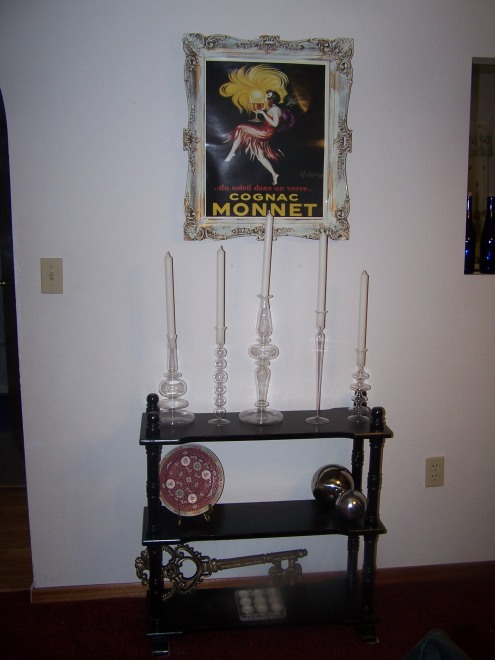 This is the little wall space next to the window. I love this set up. I always love antique frames.