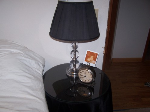 A close up view of the side table. This one happens to be Tony's.