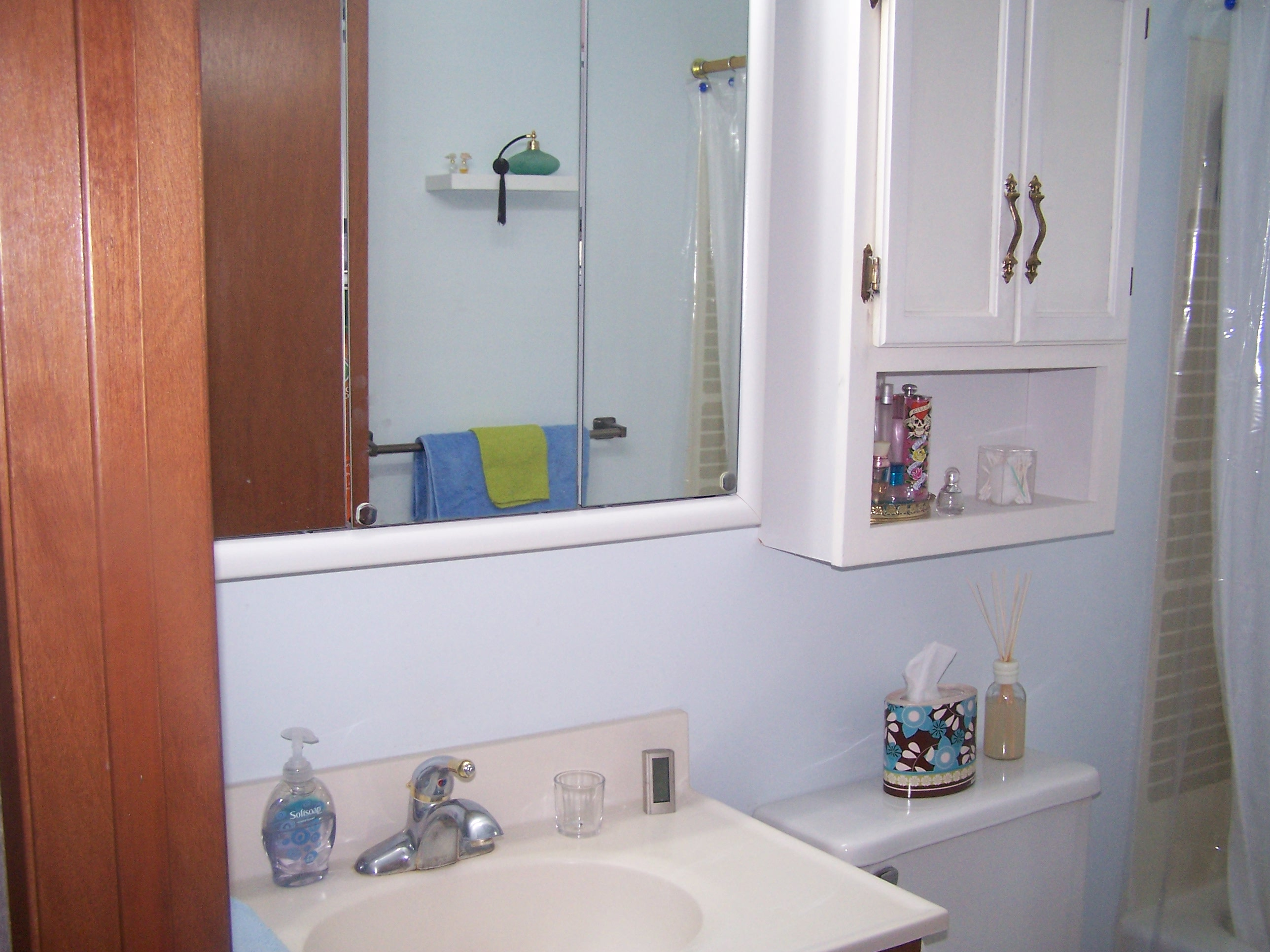 Close up of sink and storage.  Pretty much the entire bathroom.