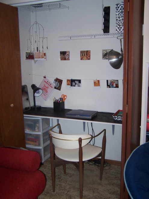 This is the closet office.  Tony made this desk for me.  I used wire to hang pictures.  I'm not sure, but even after editing, it still feels a little cluttered to me.  Any suggestions?