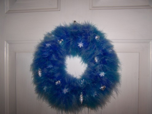 The wreath. I made this with a foam wreath and 2 boas. Then pinned tiny ornaments to it. My mom's idea, I can't take credit.
