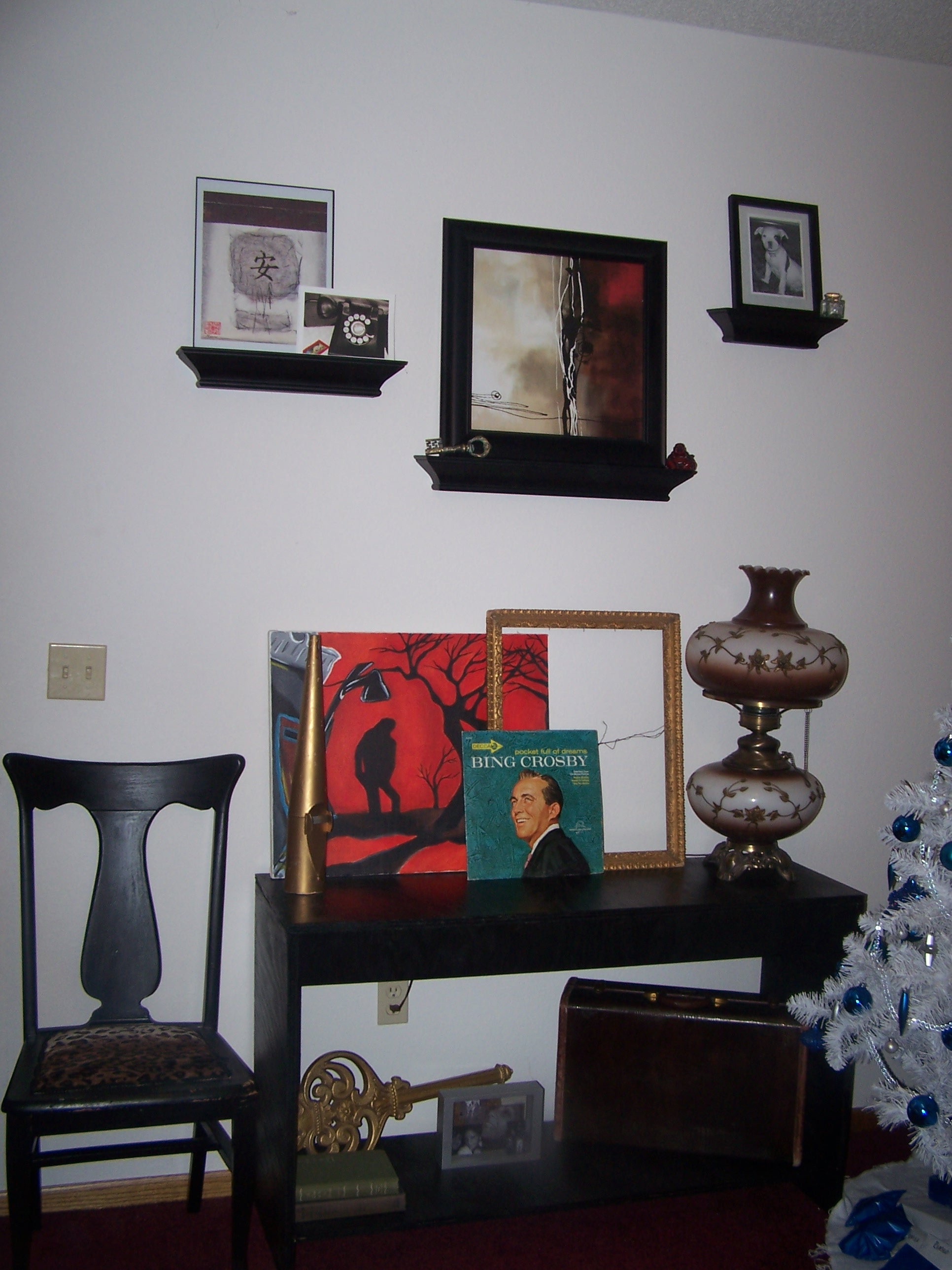 Console table with the shelves above it.  The black chair was a project I redid.