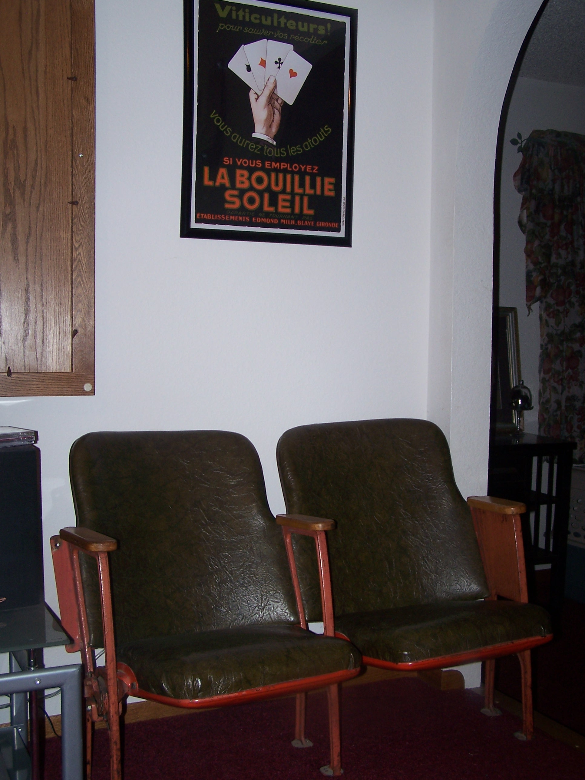 These old movie theater seats were a salvaged find.  They sit next to the TV on the right.  The vintage ad above matches them so well.