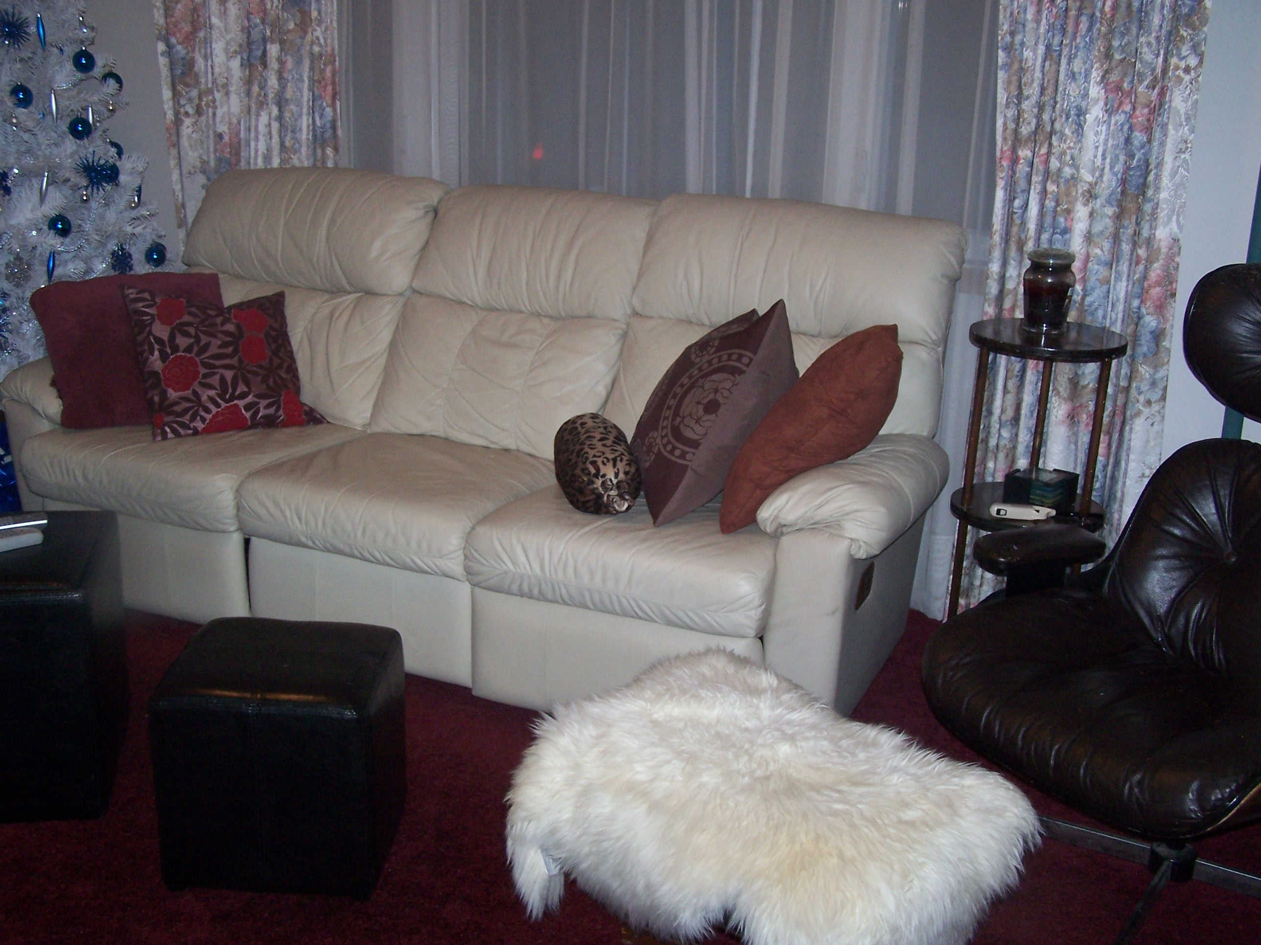 The couch is directly facing the TV.  We still want to replace those flowery curtains, but the couch is comfy and cute- we got lucky for a hand-me-down!