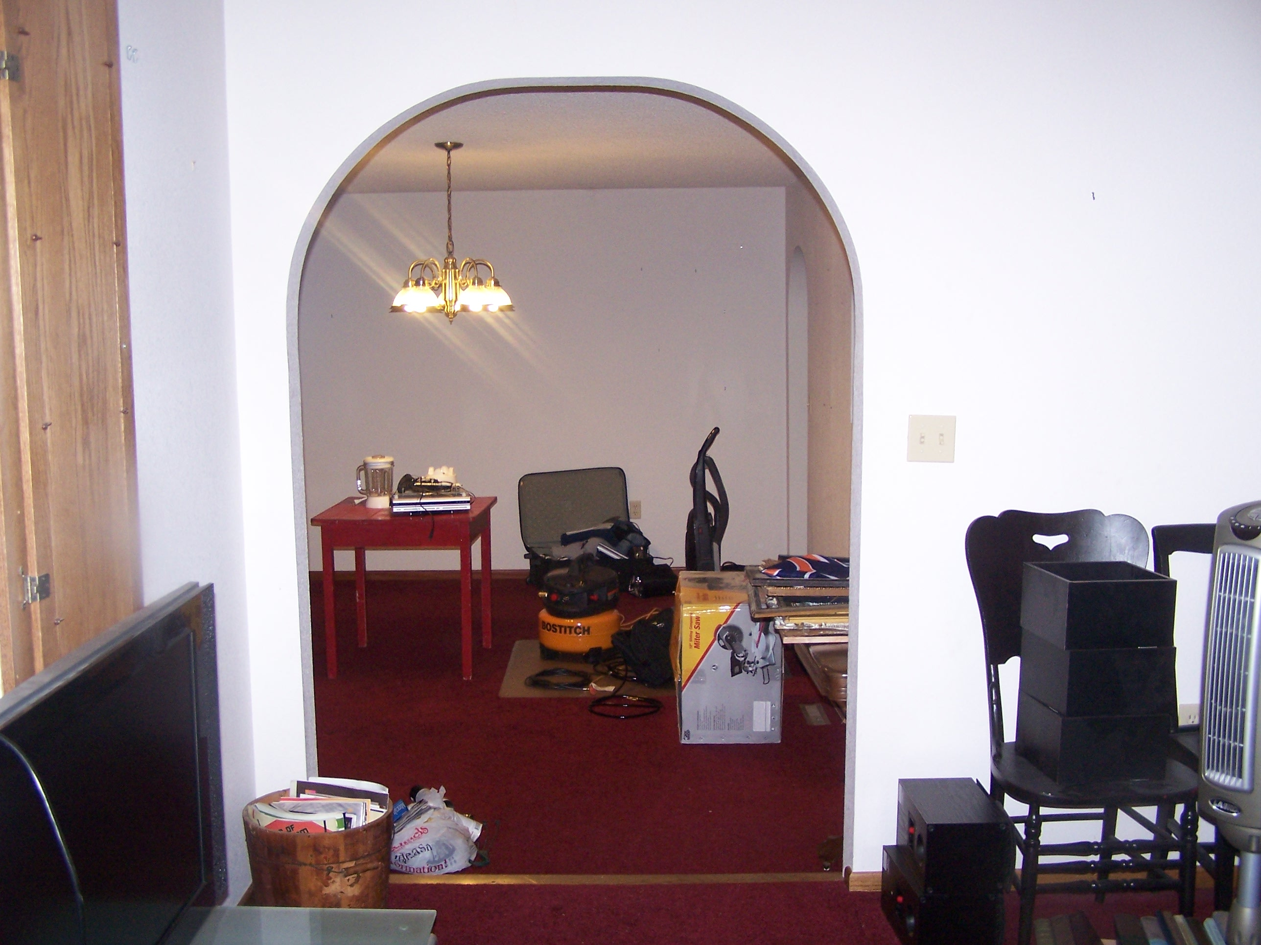 A view from the living room into the dining room. Stuff was everywhere!