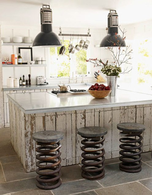 http://www.apartmenttherapy.com/boston/green-ideas/repurposed-truck-spring-kitchen-stools-064396
