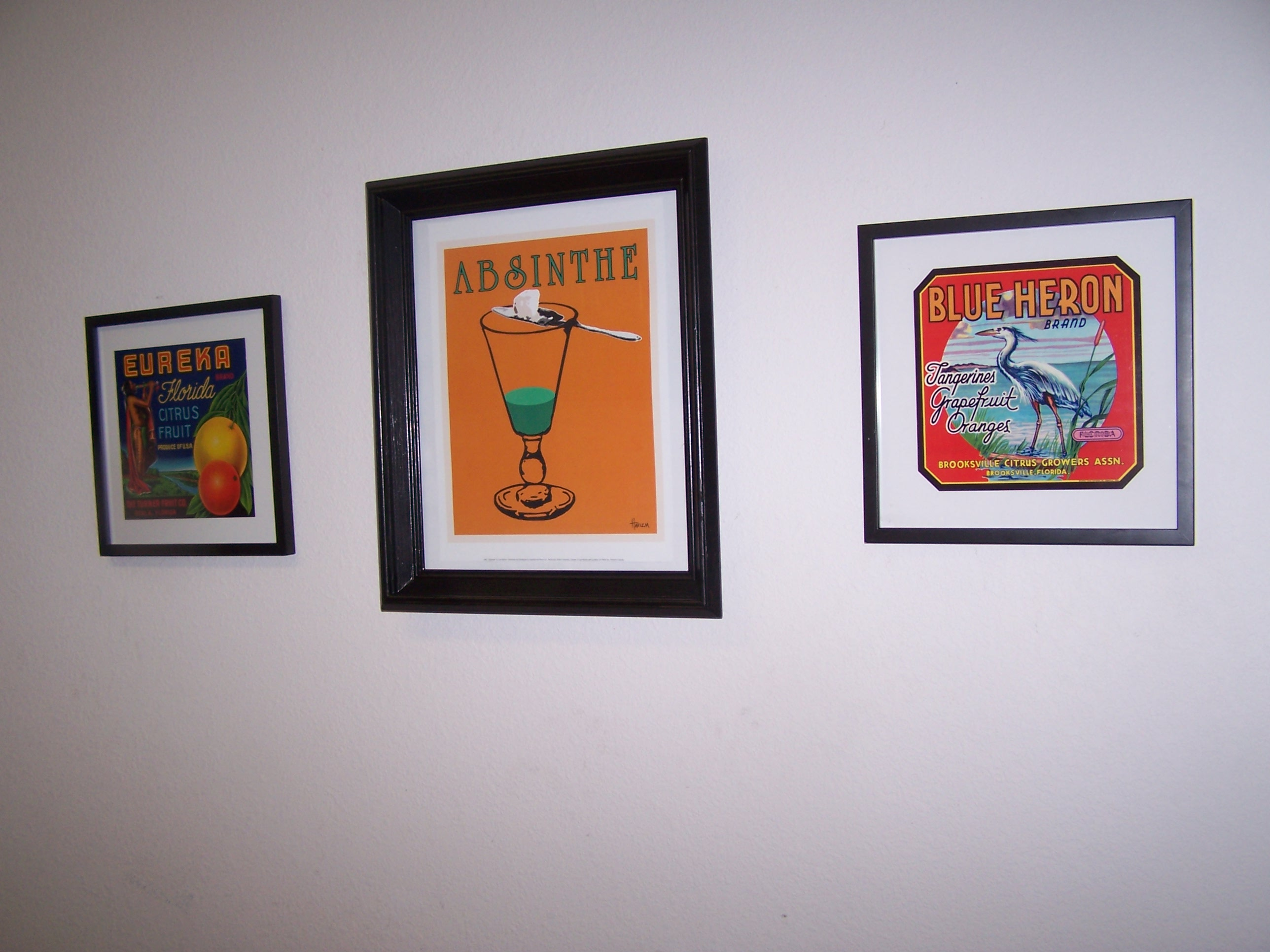 A close up of the framed ads