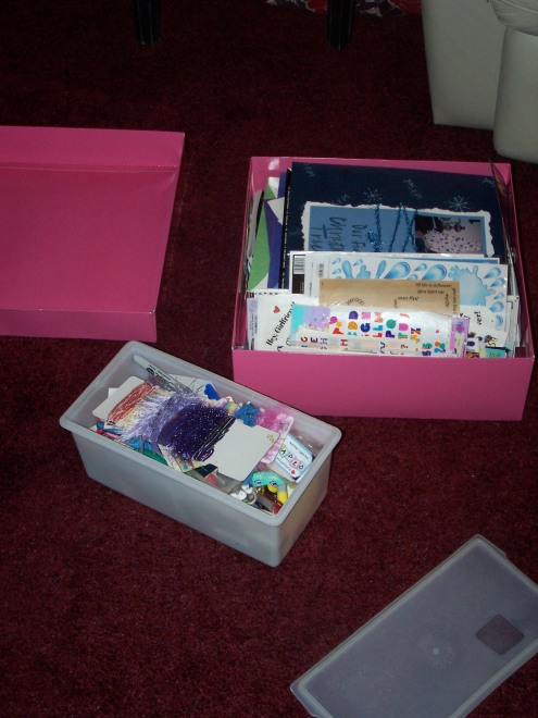 Here are just a couple of my unruly boxes of scrapbooking materials.  I love the pink box, as it is an oversized gift box from Victoria's Secret, but the heavy materials are starting to demolish the box!