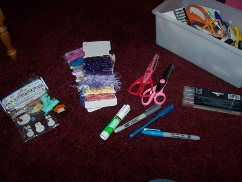 Here is just a glimpse of the plethora of supplies needed for scrapbooking.  Scissors, stickers, markers, pens, accessories, paper...