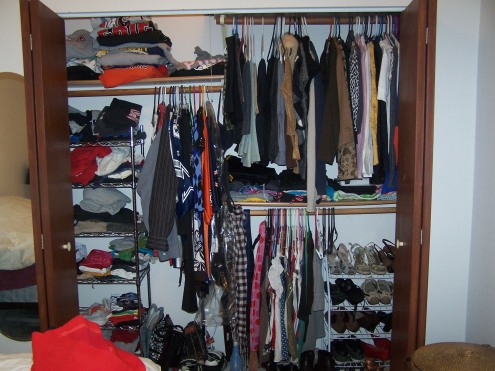 """This is a view of the closet as a whole.  The shelving was already installed when we moved in, so we are using it as-is.  It is helpful, but we do not have """"sides,""""  just """"areas.""""  A little confusing at first, but now it works."""