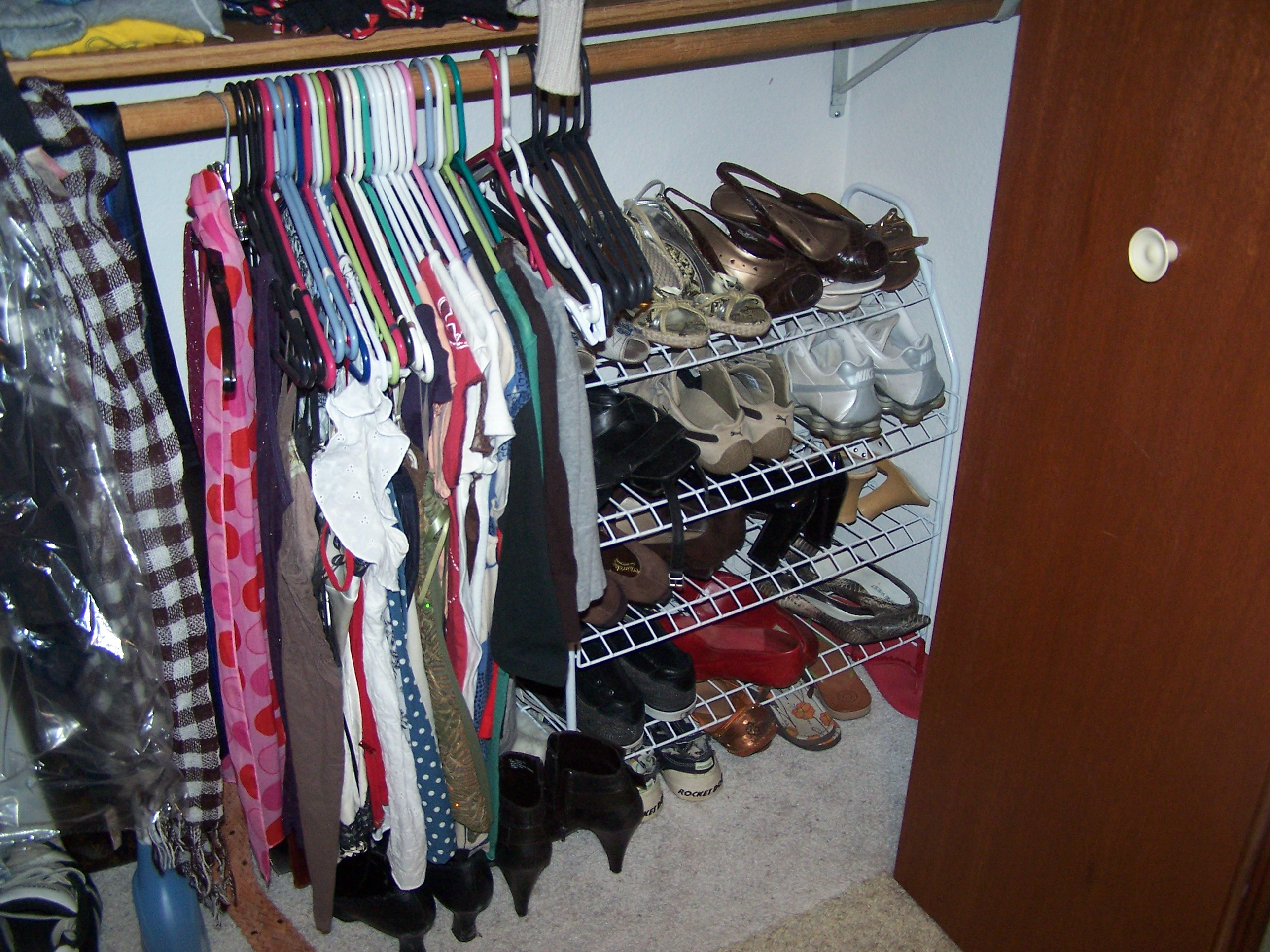 We hang belts, scarves, and ties on the low bar, along with a few of my shorter shirts.  My giant shoe rack fits in the corner.