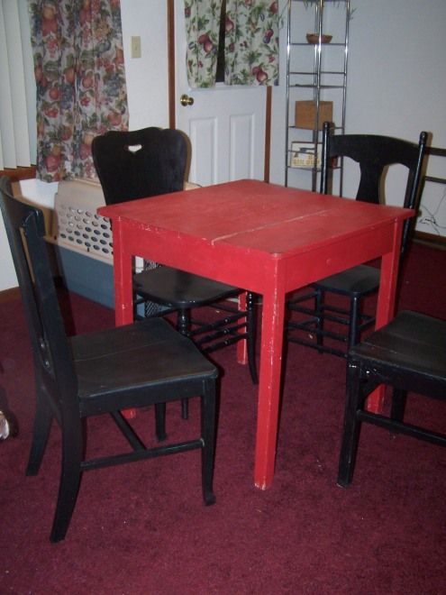 This is our little dining table.  It is very old and imperfect, but, it has so much character and personality.  Even the chairs are worn-in, and mismatched!