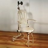A 1920's-30's doctor's chair.  I know, I love all crazy chairs, but this one would be a real conversation piece!