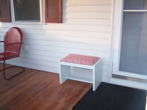 The little bench by the front door and our red vintage lawn chairs! :)