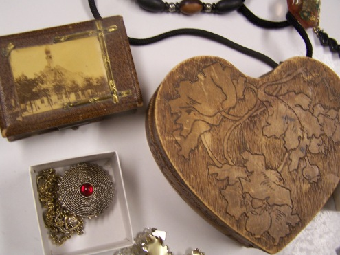 Two old jewelry boxes and a sweet locket.