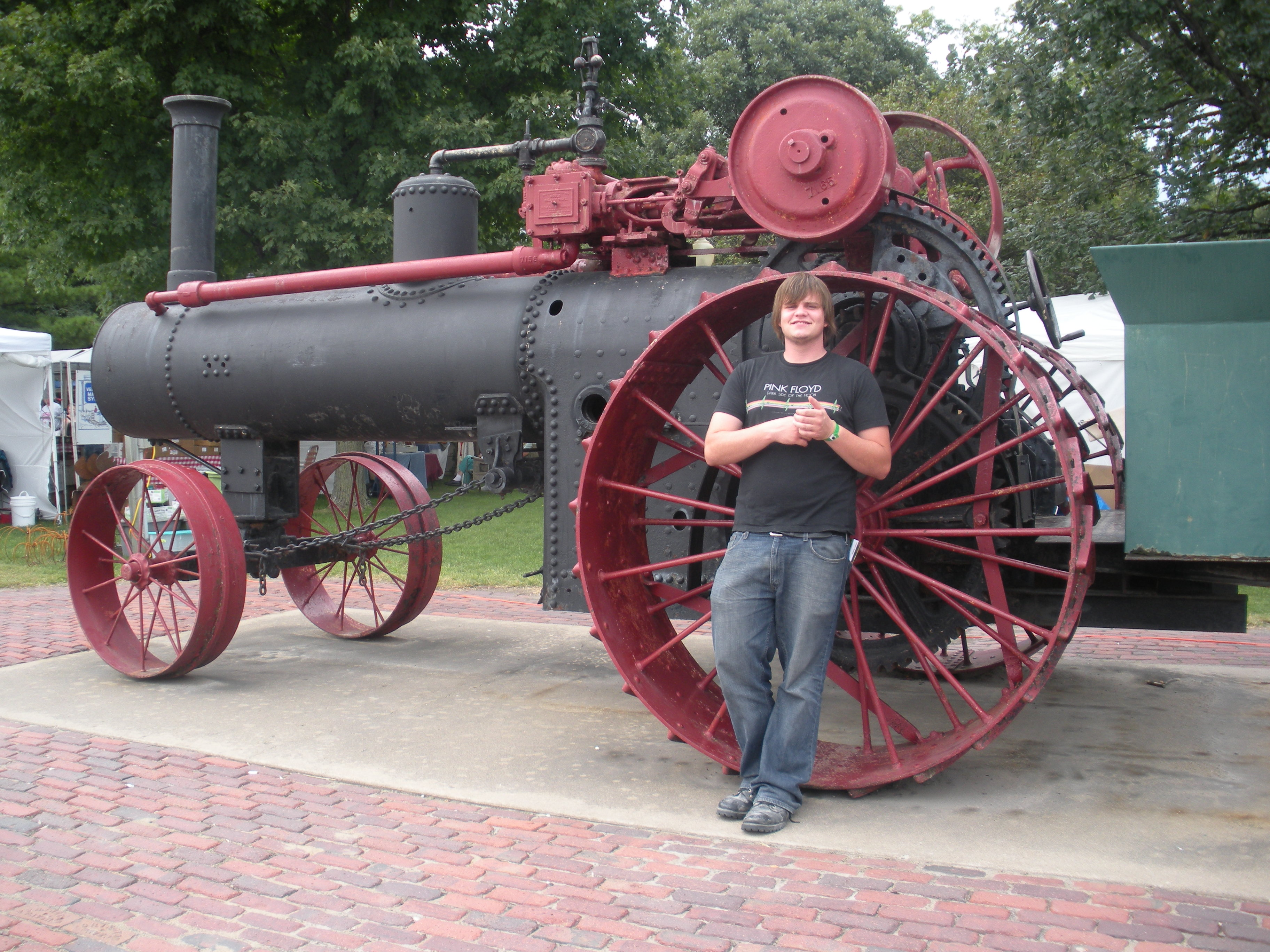 And here is Tony with a very large threshing machine, the main reason for the event!